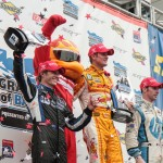 Ryan Hunter-Reay, Ryan Briscoe, Simon Pagenaud at the 2012 Grand Prix of Baltimore Victory Lane Stage